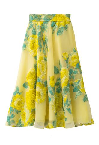 イエローのシースルーオーガンジーにイエローとグリーンのフラワー刺繍が施されたスカート